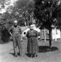 Fred and Wava Green stand outside in the back yard, circa 1951